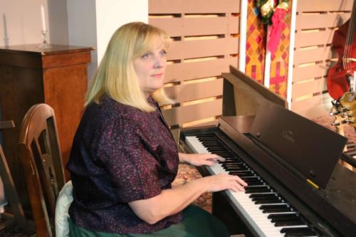 Vera on piano